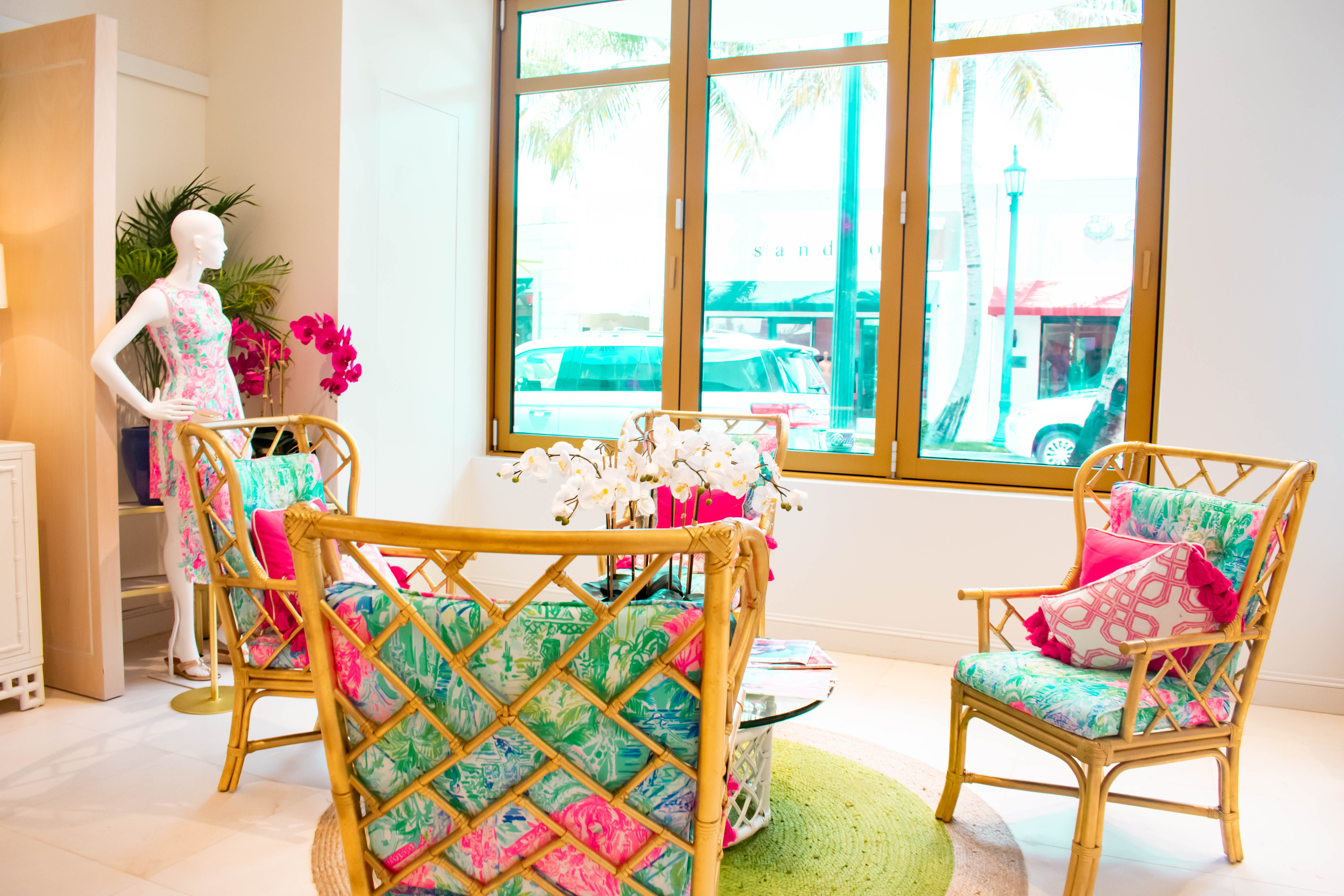 inside lilly pulitzer worth avenue flagship store preppy seating area vintage interior design palm beach island florida