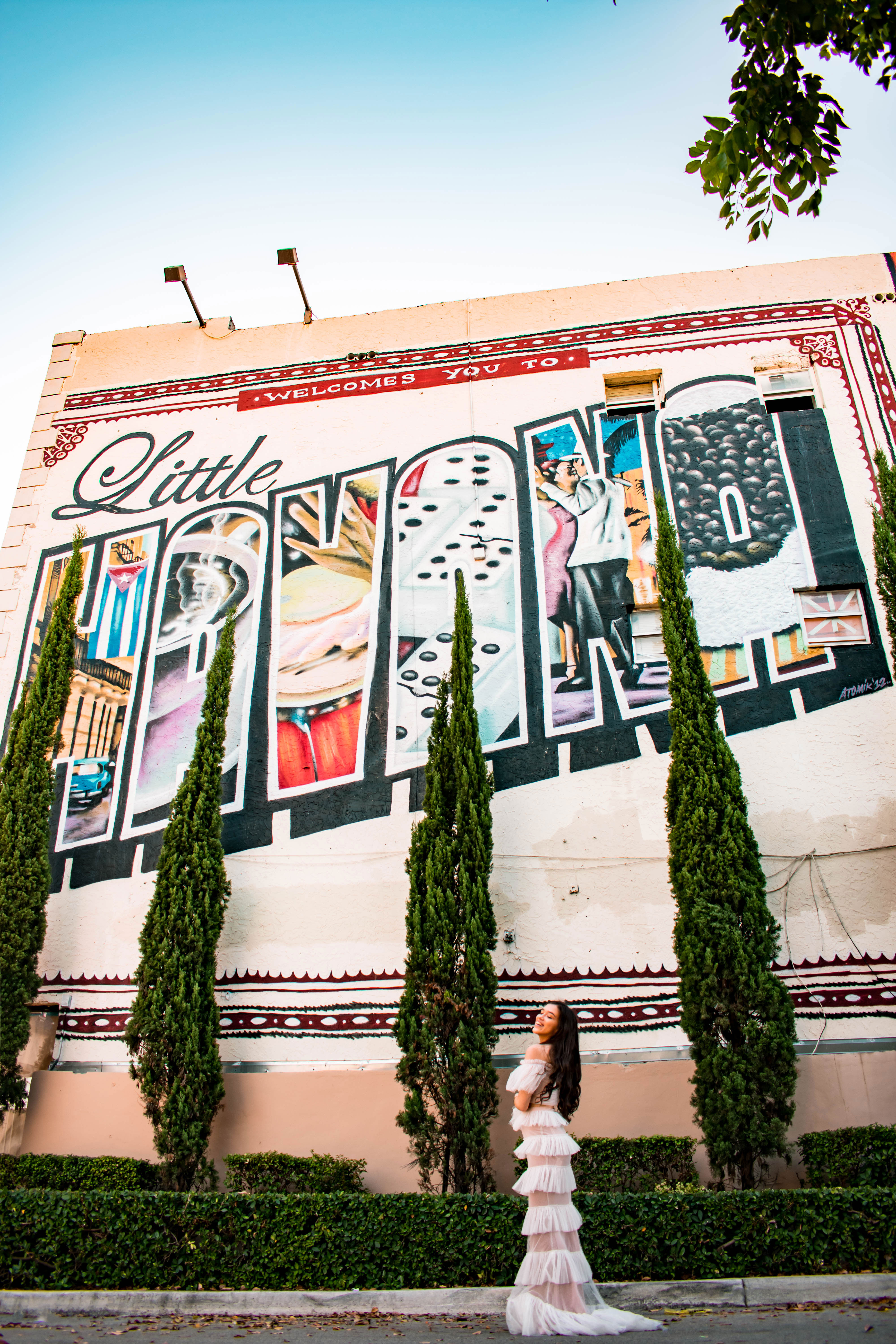 Eva Phan of Eva Darling little havana miami florida instagrammable welcome to little havana mural portia and scarlett white ruffle set prom dress newyorkdress where to go miami travel guide calle ocho luxury travel blogger