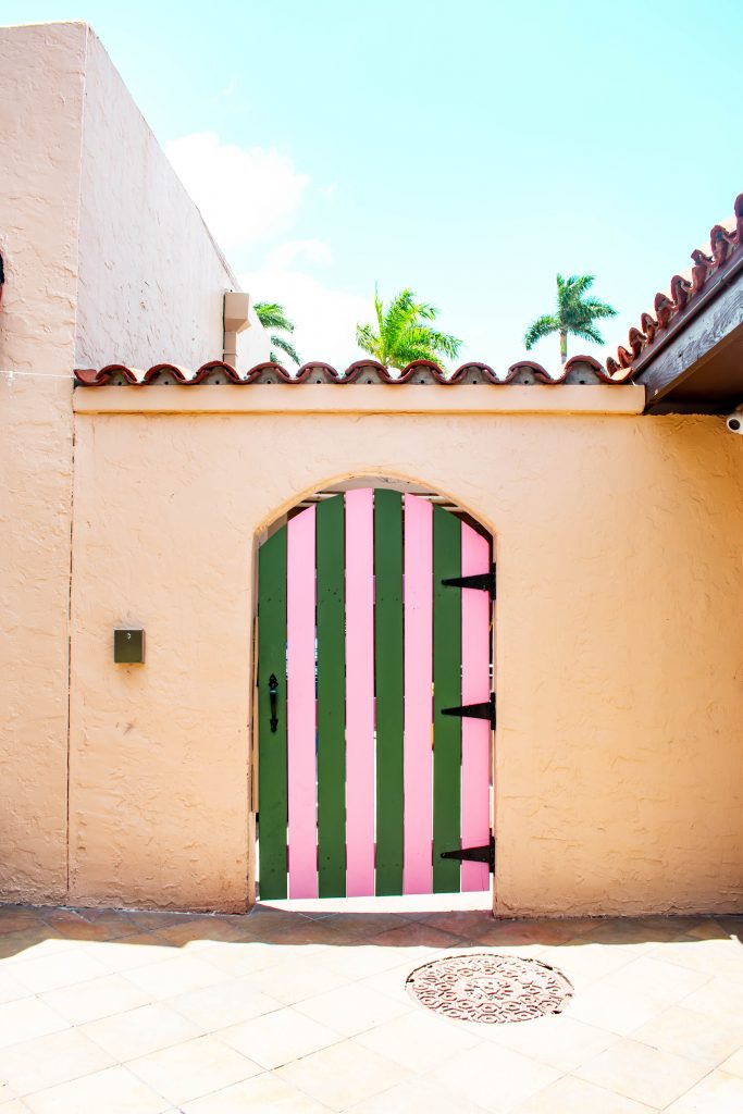 pink and green instagrammable door palm beach island florida photo location