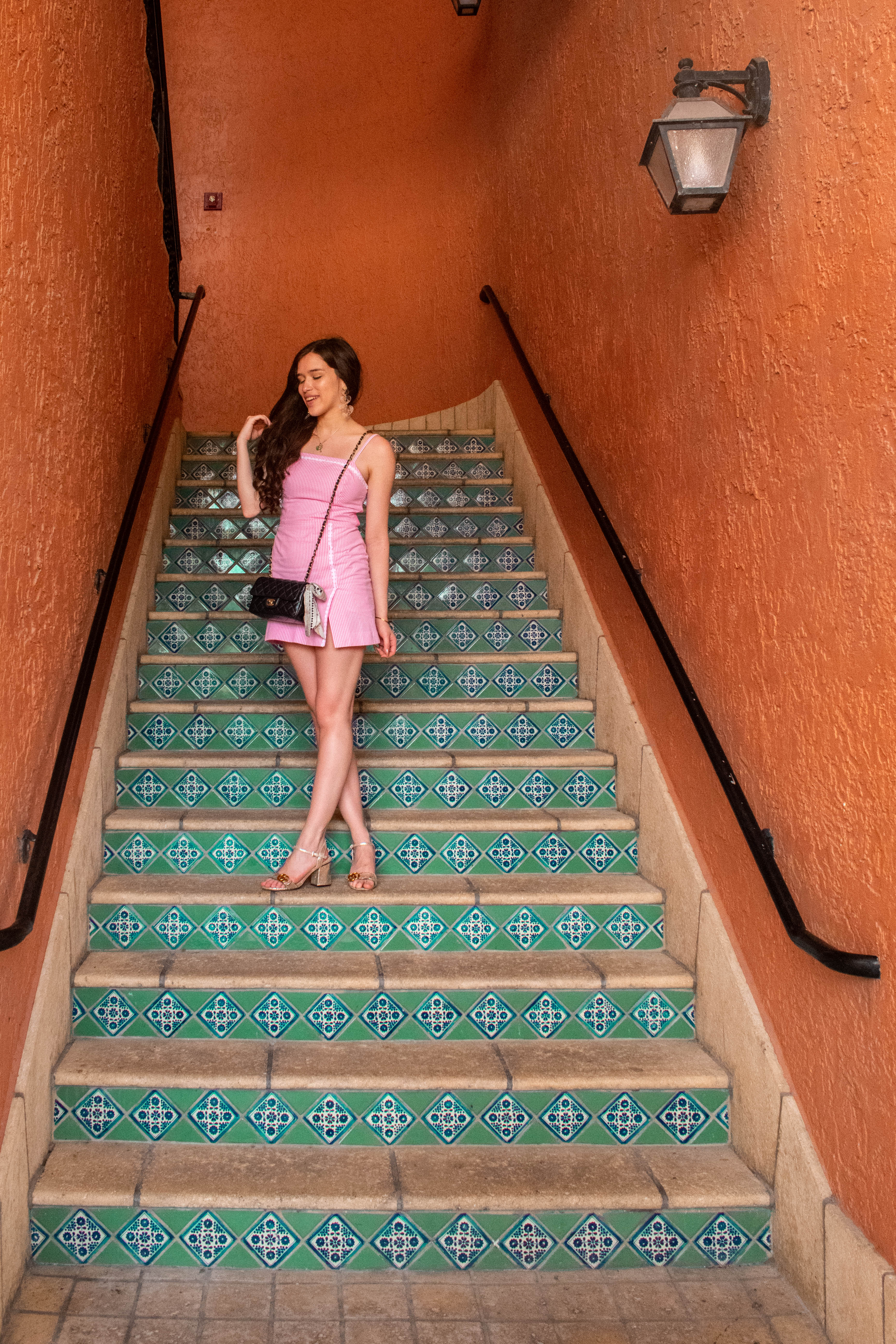 travel and preppy style blogger eva phan of eva darling at rosemary square west palm beach tiled staircase lilly pulitzer jesse romper pink yarn dyed stripe seersucker southern style summer outfit inspiration cityplace