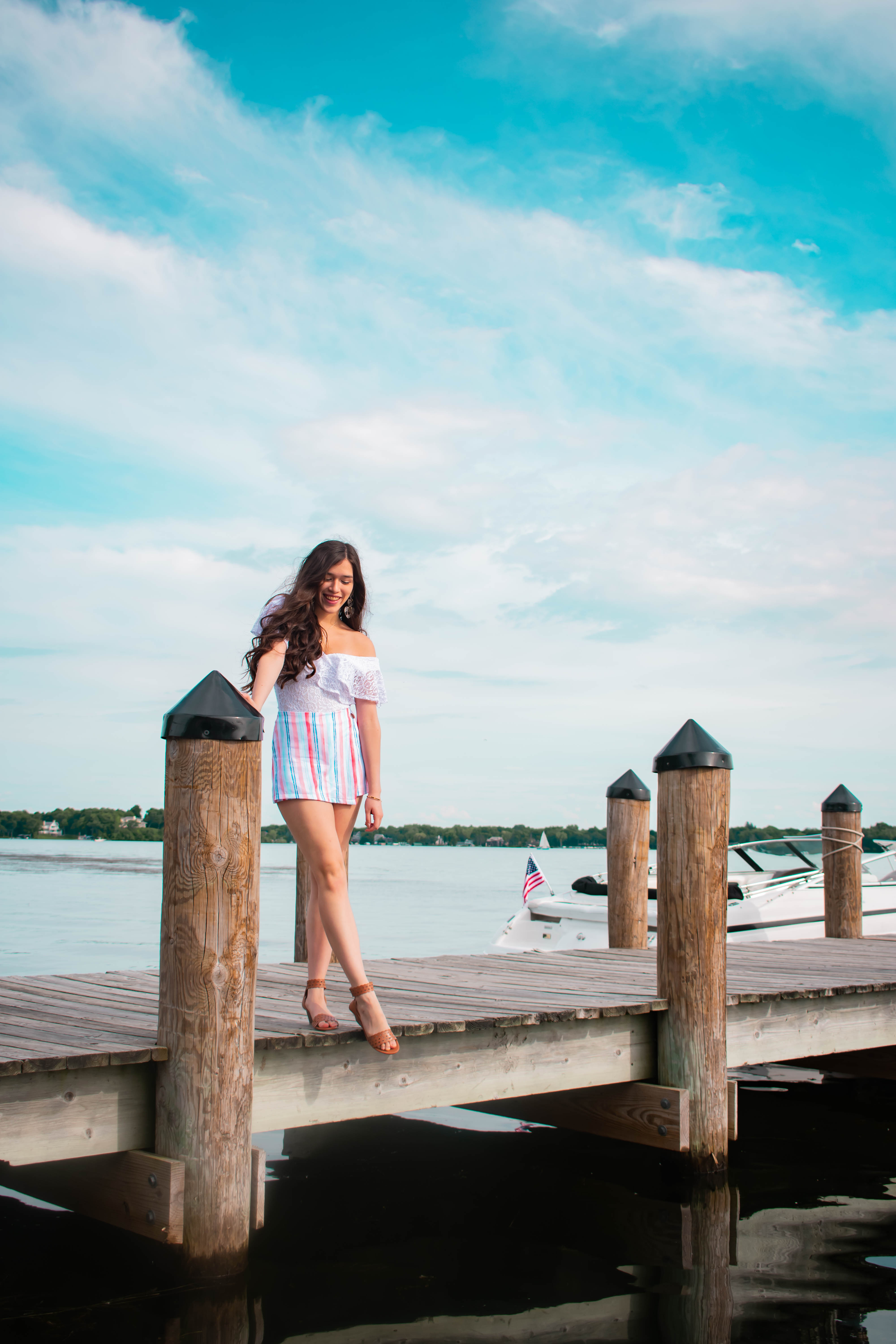 Eva Phan of Eva Darling lake minnetonka wayzata minnesota xoxo clothing trendy summer outfit inexpensive college girl style white lace bodysuit red white and blue striped mini skort comfortable summer brown wedge sandals style travel blogger mn