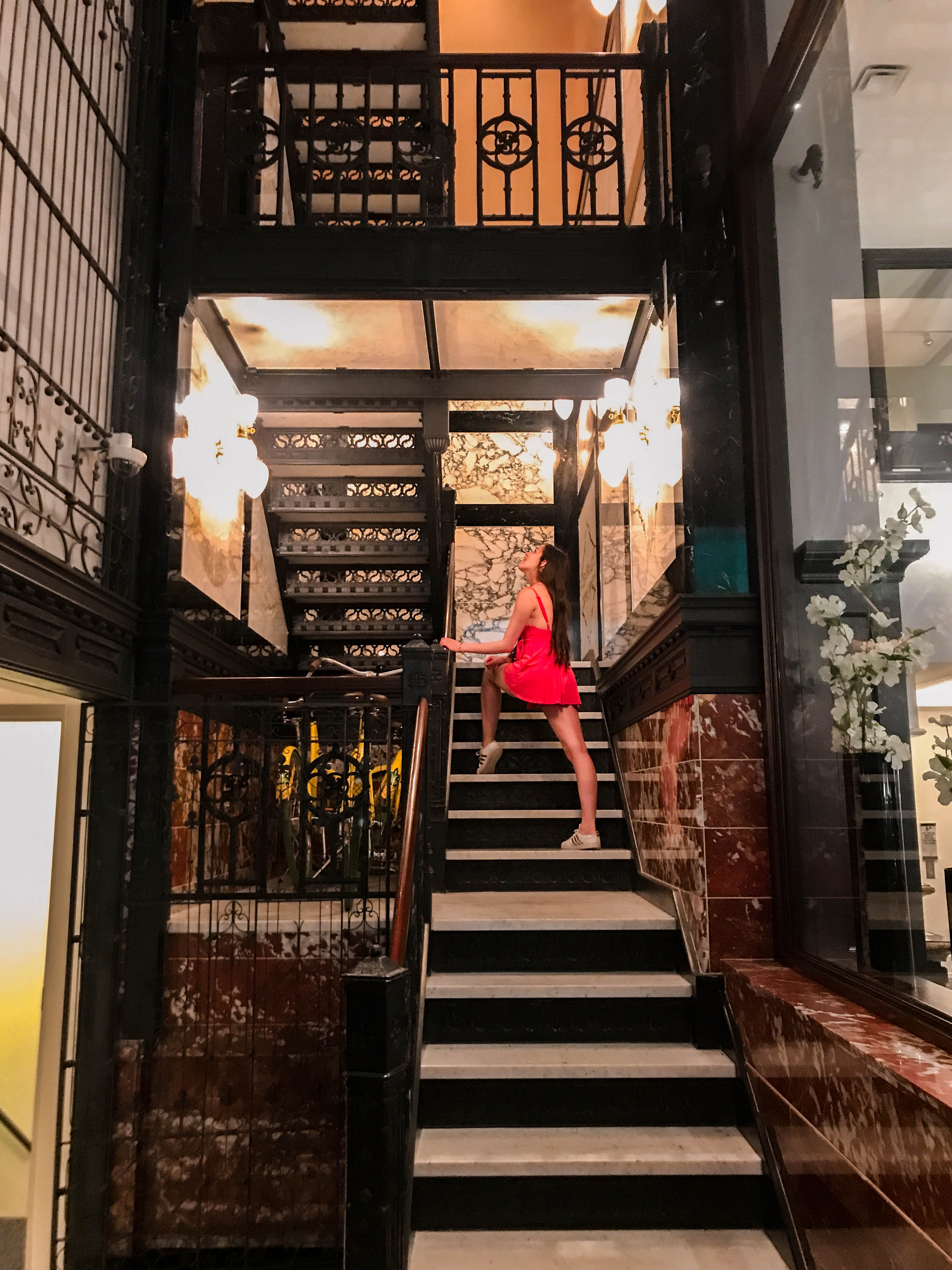 travel blogger eva phan of eva darling staypineapple chicago hotel affordable boutique hotel the loop budget travel midwest united states urban outfitters veruca wrap romper adidas gold baseline sneakers