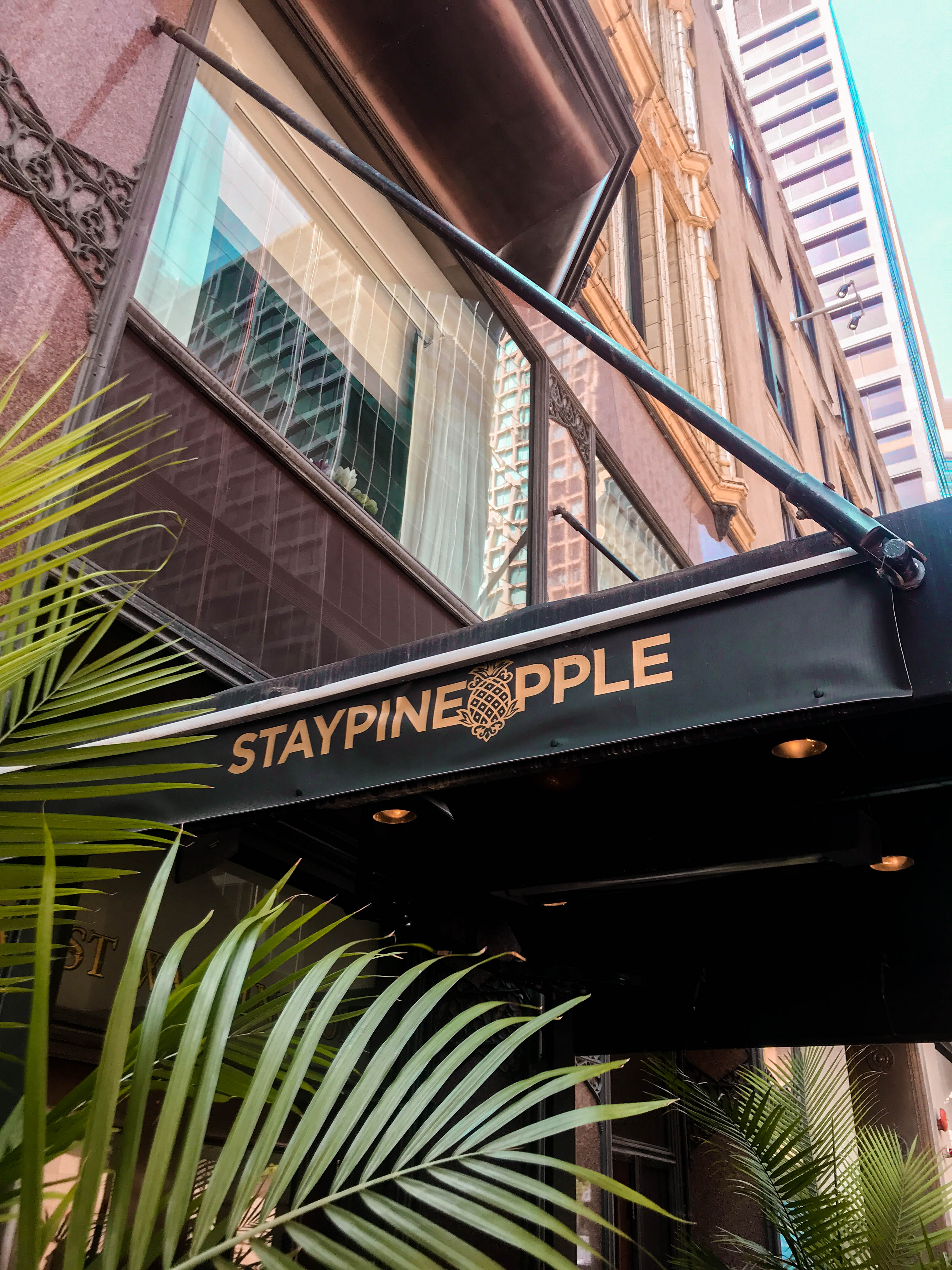 Staypineapple chicago an iconic hotel the loop exterior awning street view washington st