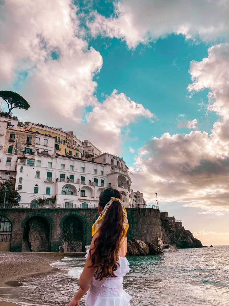 travel blogger eva phan eva darling amalfi beach italy road trip tyrrhenian sea solo female travel what to do on the amalfi coast things to do in amalfi best places to go in Italy lilly pulitzer olive dress shein lemon hair scarf luxury travel bachelorette party idea