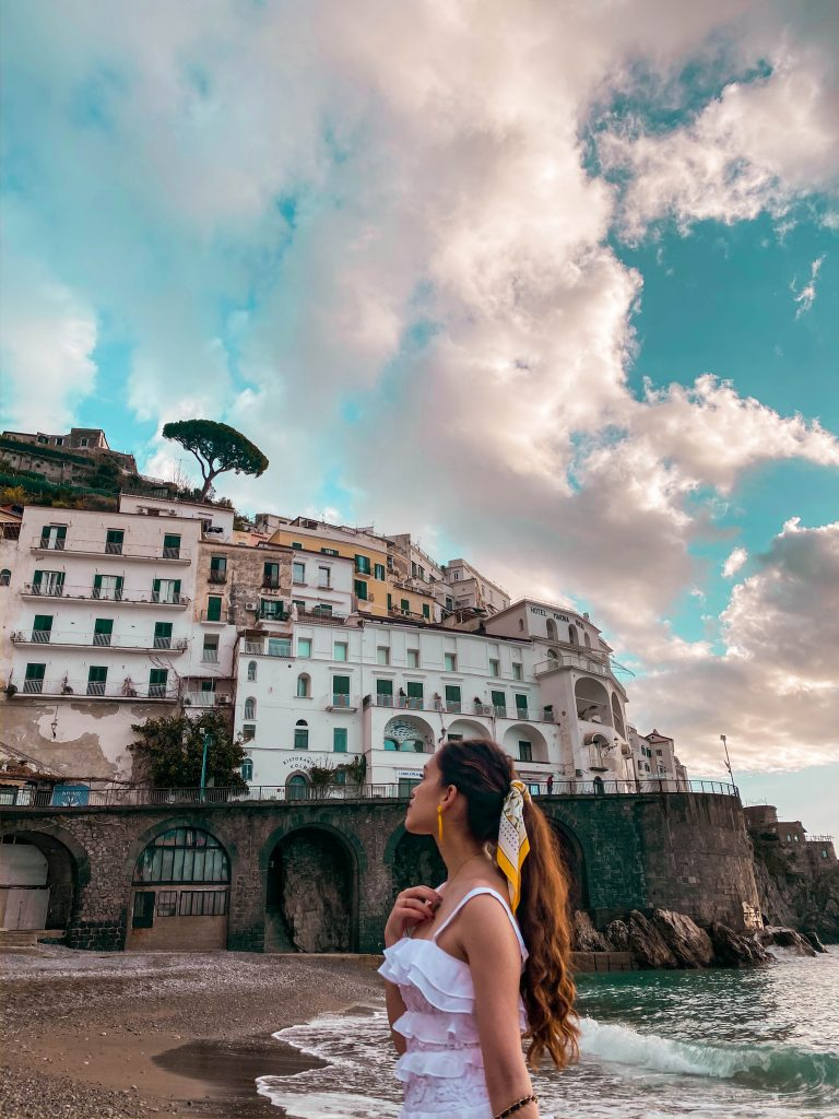 travel blogger eva phan eva darling amalfi beach italy road trip tyrrhenian sea solo female travel what to do on the amalfi coast things to do in amalfi best places to go in Italy lilly pulitzer olive dress