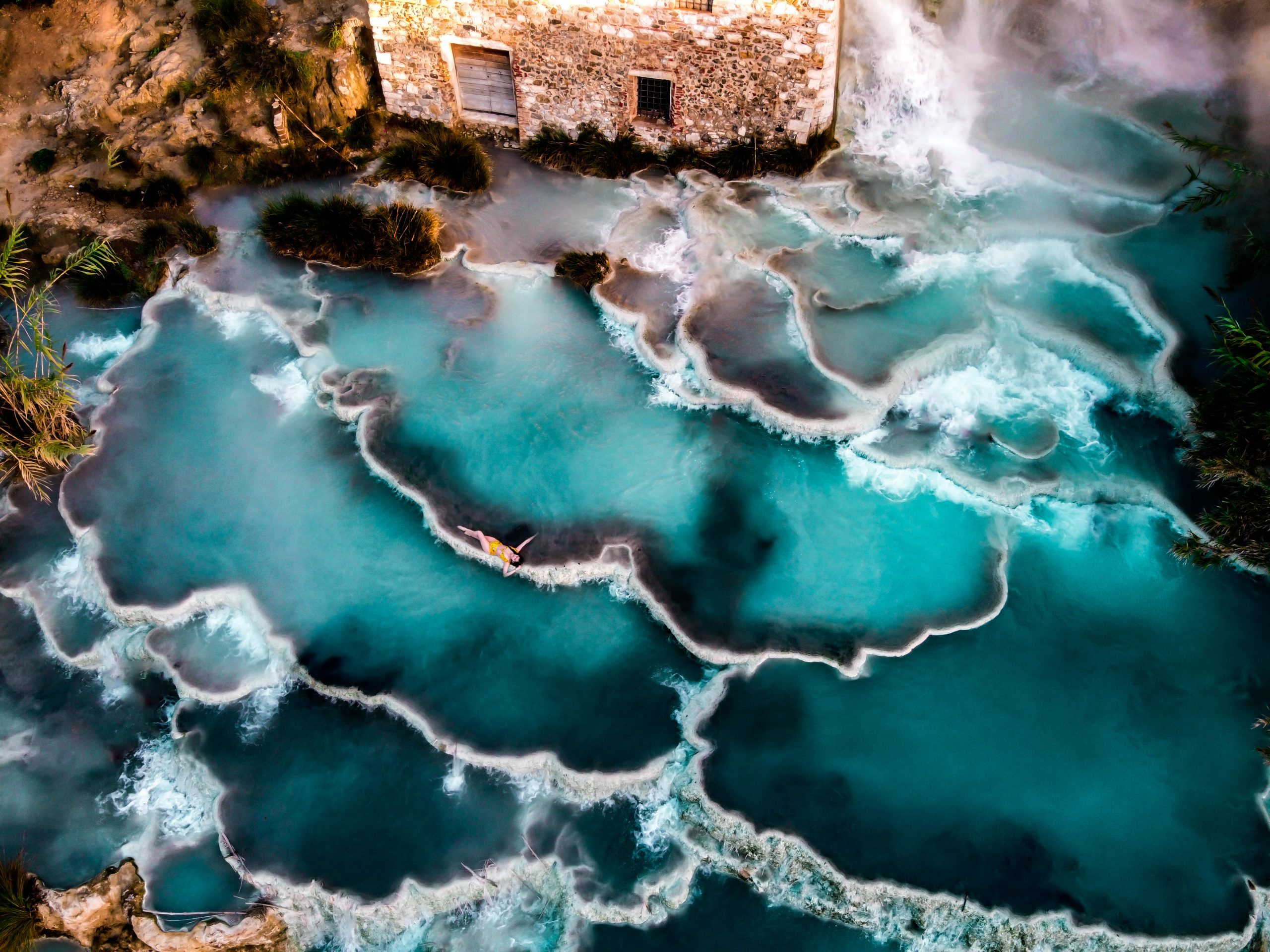 eva phan cascate del mulino instagrammable spots terme di saturnia natural hot springs tuscany thermal bath spa italy solo female travel province of grosseto italy where to go tuscany dji mavic mini drone photography shein inexpensive yellow high waisted bikini