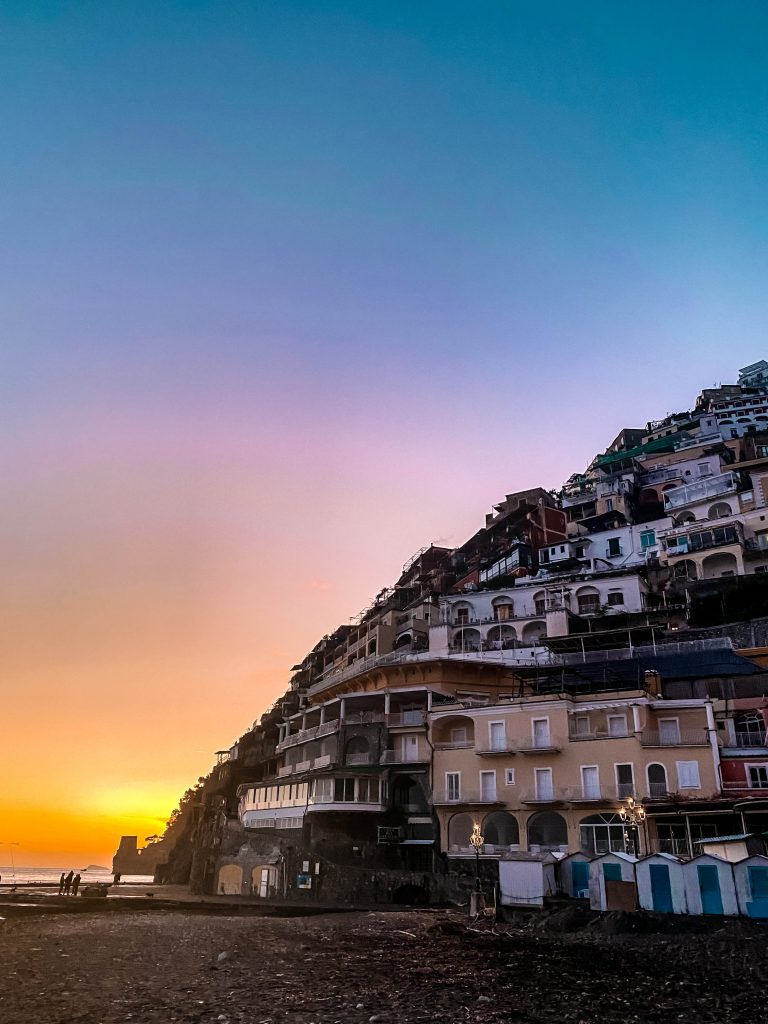 positano italy hill sunset golden hour winter off season amalfi coast road trip destination wanderlust mountainside beach