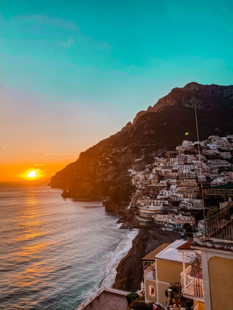 positano italy hill sunset golden hour winter off season amalfi coast road trip destination wanderlust beach overlook