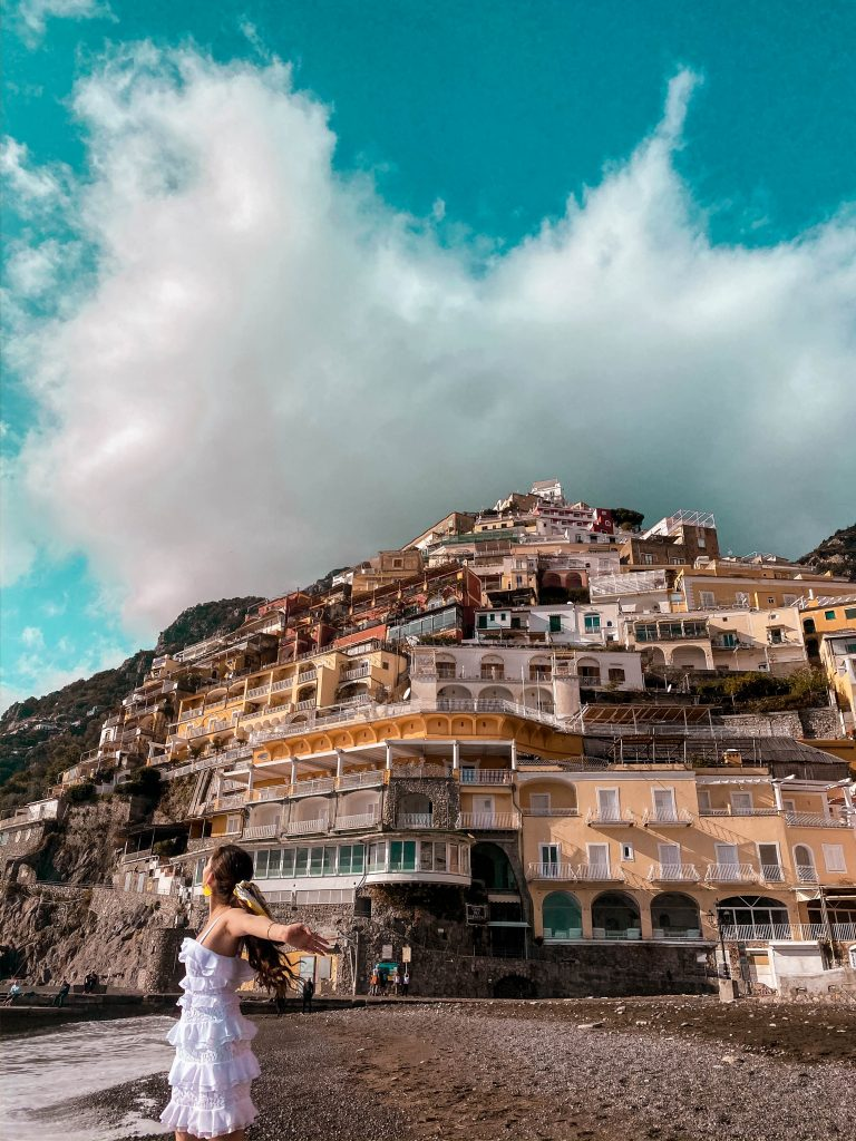 positano beach winter off season empty province of salerno amalfi coast italy lemon lilly pulitzer olive dress travel blogger solo female travel hill town