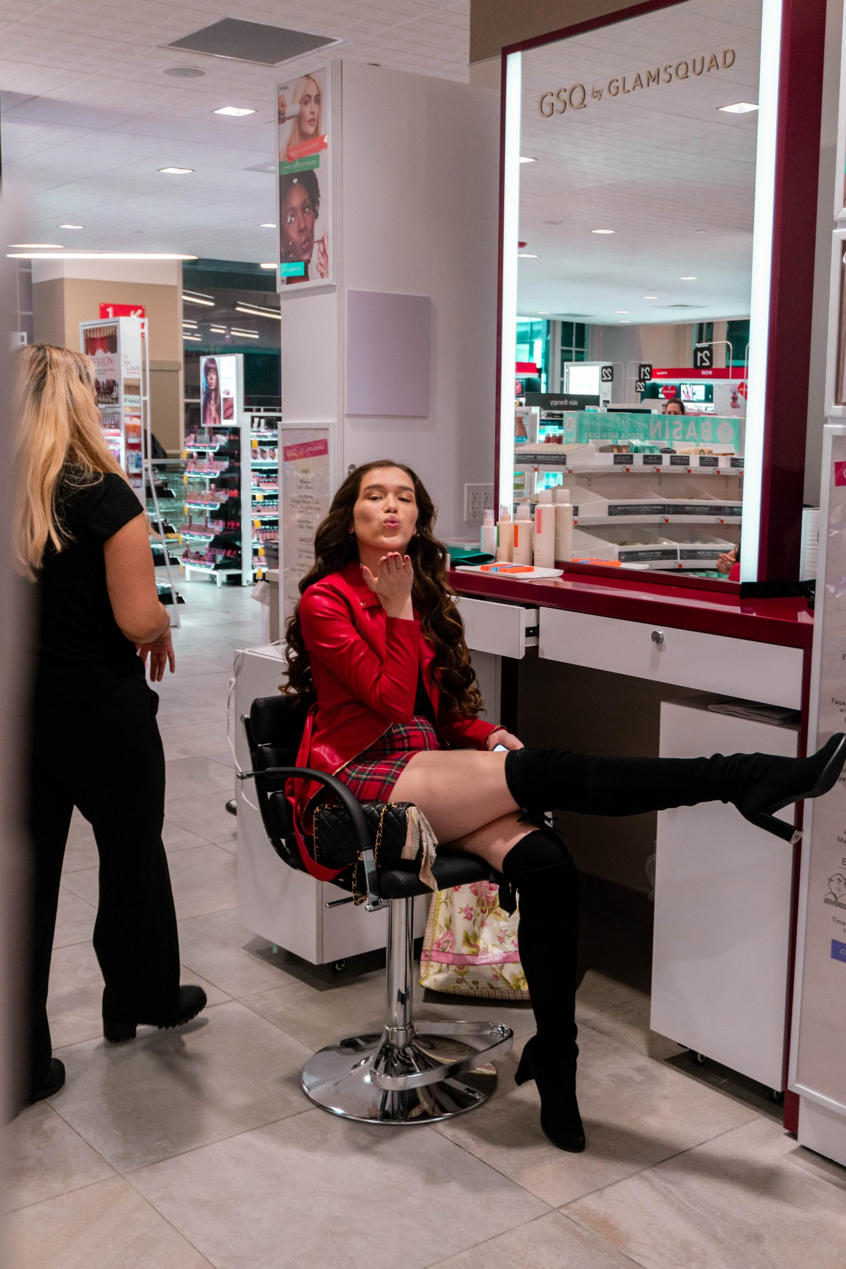 Eva Phan of Eva Darling at CVS Beauty Destination's GSQ by Glamsquad styling services blowing a kiss