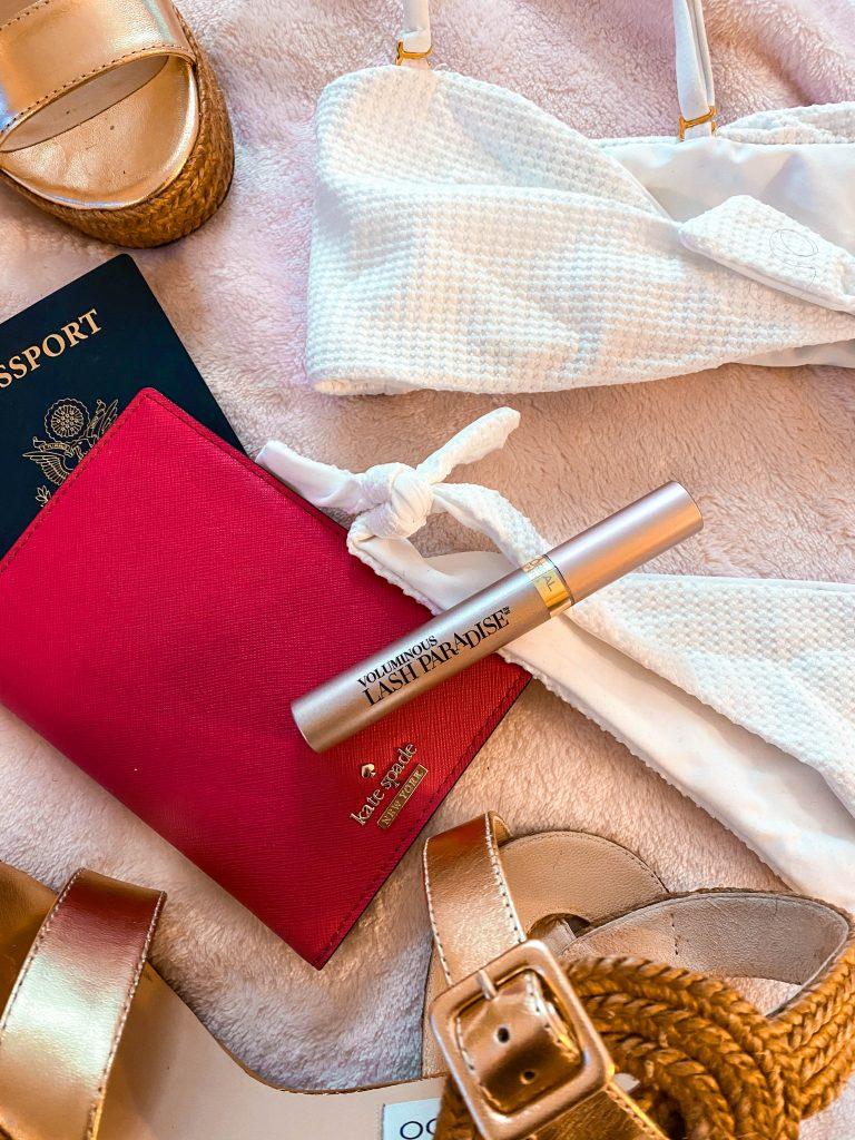 l'oreal lash paradise mascara travel flatlay free luggage tag beach bunny swimwear white bikini
