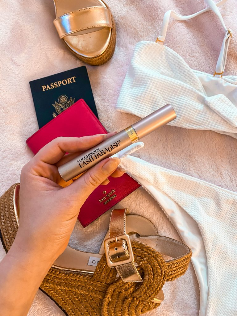 l'oreal lash paradise mascara travel flatlay free luggage tag beach bunny swimwear white bikini jimmy choo delphi gold wedge
