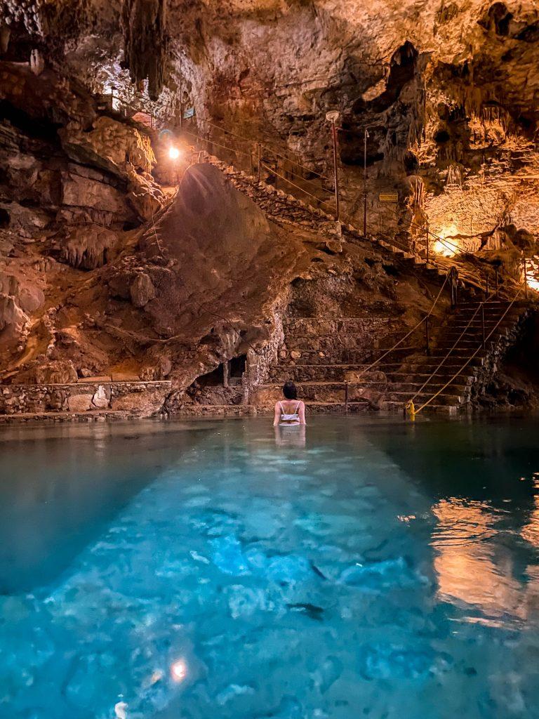 steep rock stairs cenote suytun valladolid yucatan peninsula mexico underground cave swimming unique experience white bikini travel blogger what to do in tulum mexico