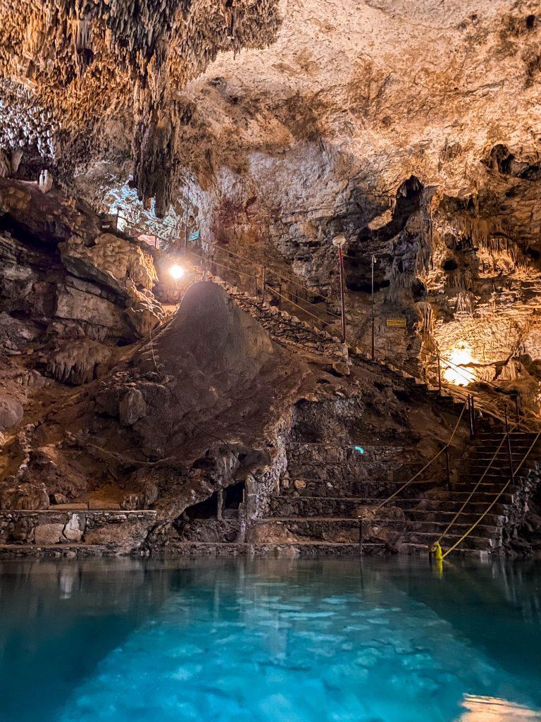 inside cenote suytun valladolid underground freshwater swimming cave steep slippery rock stairs rock formation hidden gem