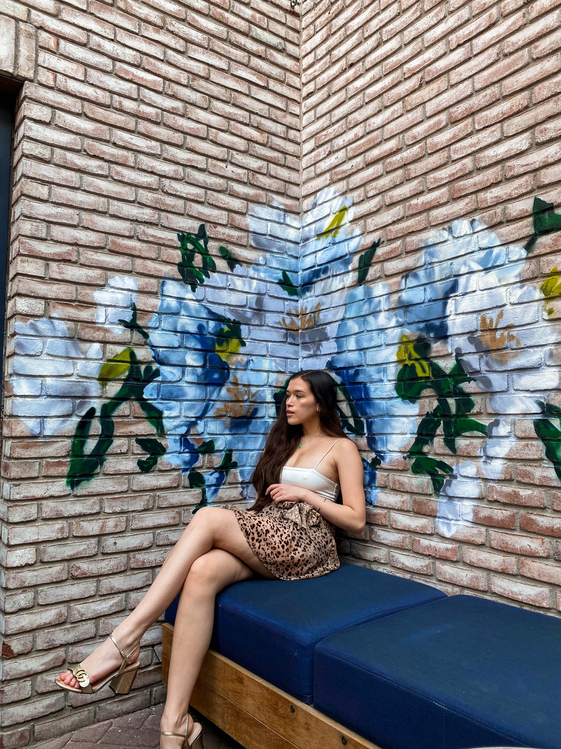 ashley joon art floral painting instagrammable rooftop bar death and co the garden ramble hotel denver colorado photo location girl brunette long straight hair sitting haute hippie cheetah wrap skirt shein cami crop top inexpensive gucci marmont gold metallic leather block sandal heels