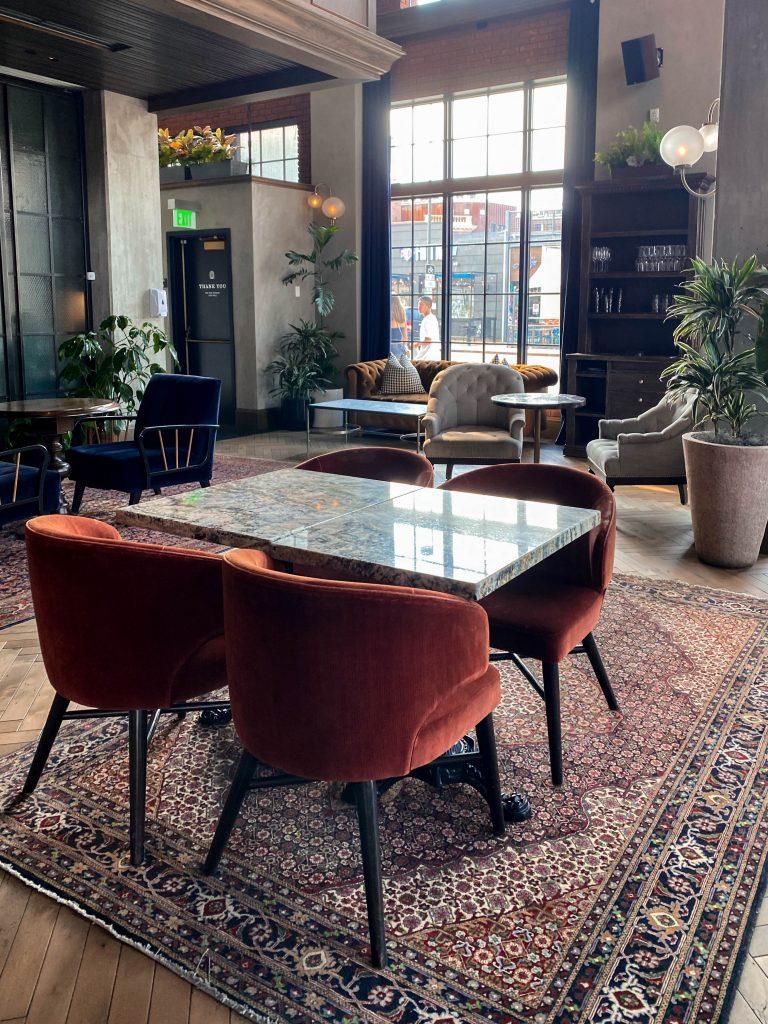 the ramble hotel lobby oriental rug orange velvet chairs blue marble table