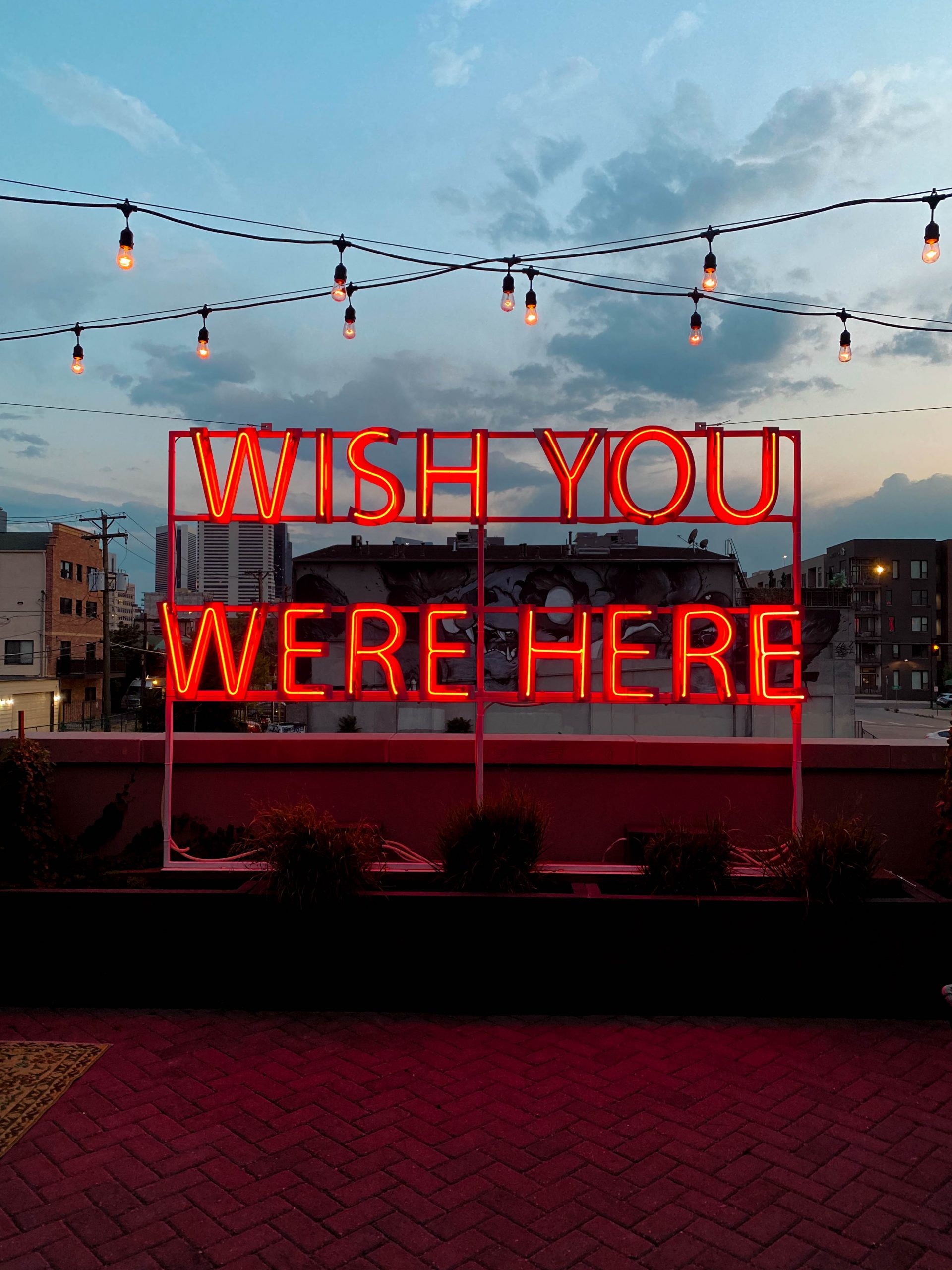 wish you were here red neon sign scott young the garden rooftop patio bar death and co