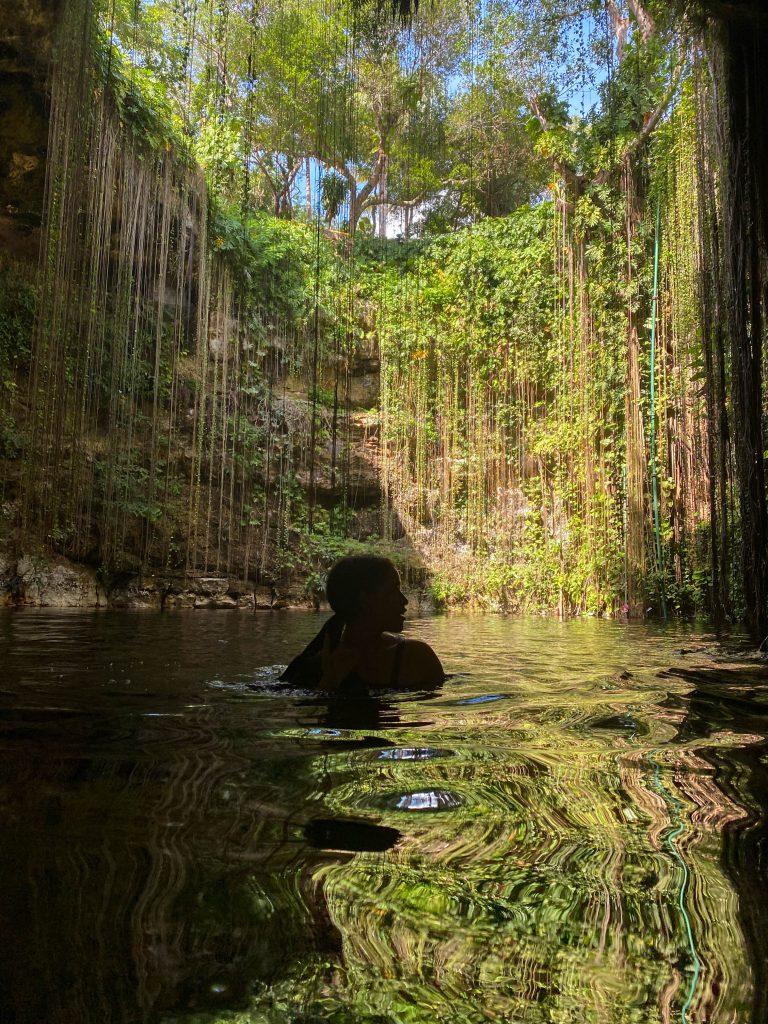 cenote ik kil hanging vines chichen itza yucatan mexico swimming pigtails sinkhole