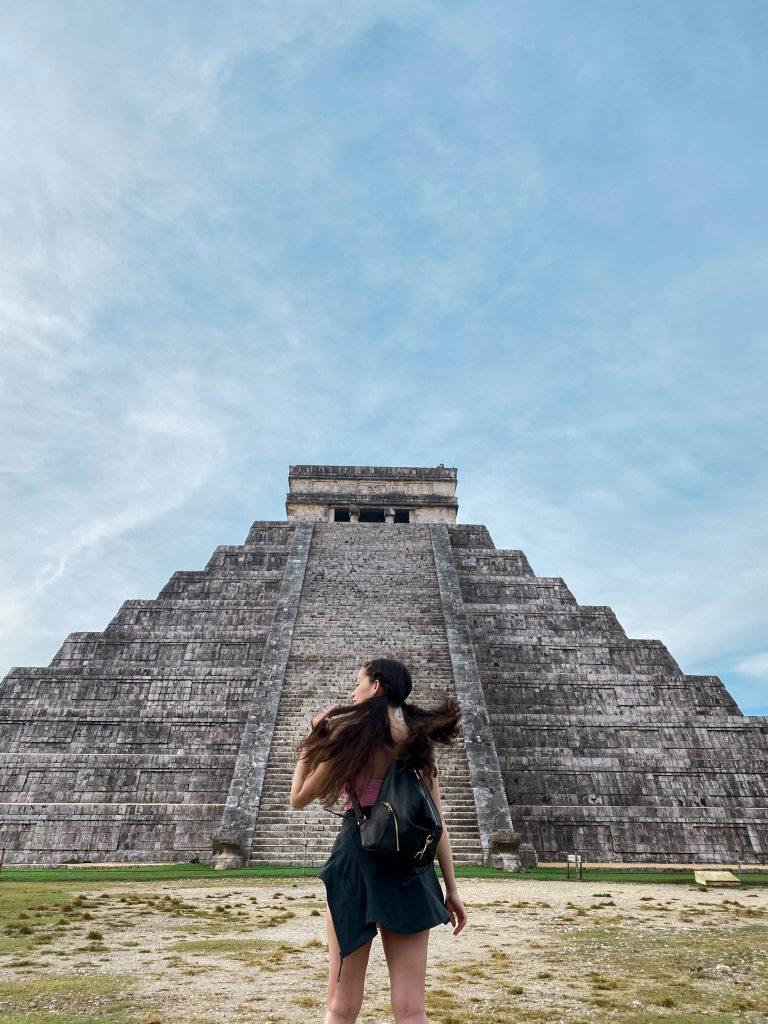 chichen itza el castillo yucatan peninsula mexico day trip rebecca minkoff julian backpack lululemon define jacket meshki cami mayan ruins eva phan brunette pigtails