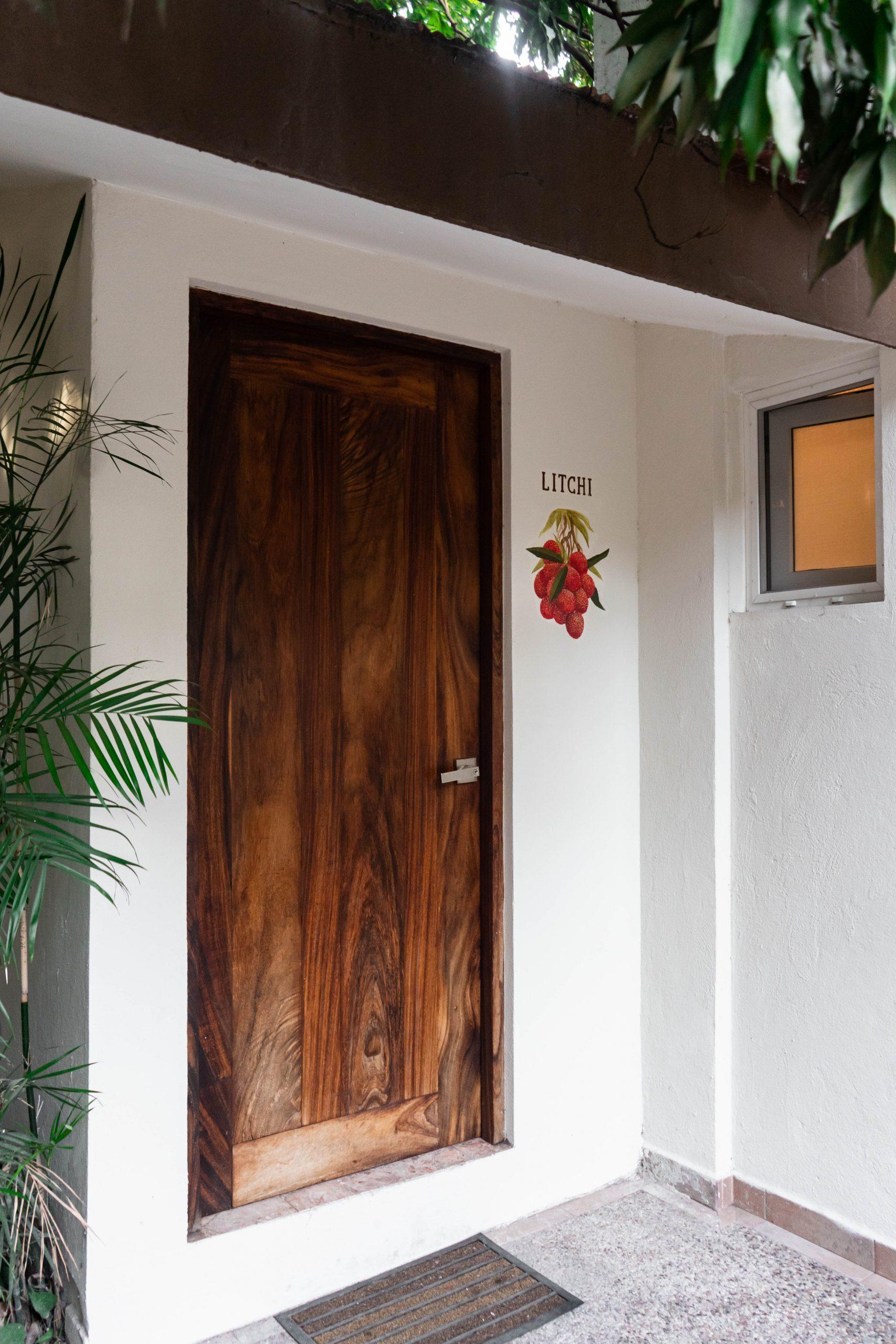 litchi room hotel casa ortiz ciudad valles la huasteca potosina san luis potosi mexico lychee fruit mural big wooden door