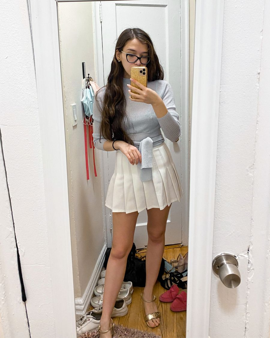 lovers and friends amery sweater light blue metallic pullover thin knit tie sweater white tennis skirt metallic gold sandal