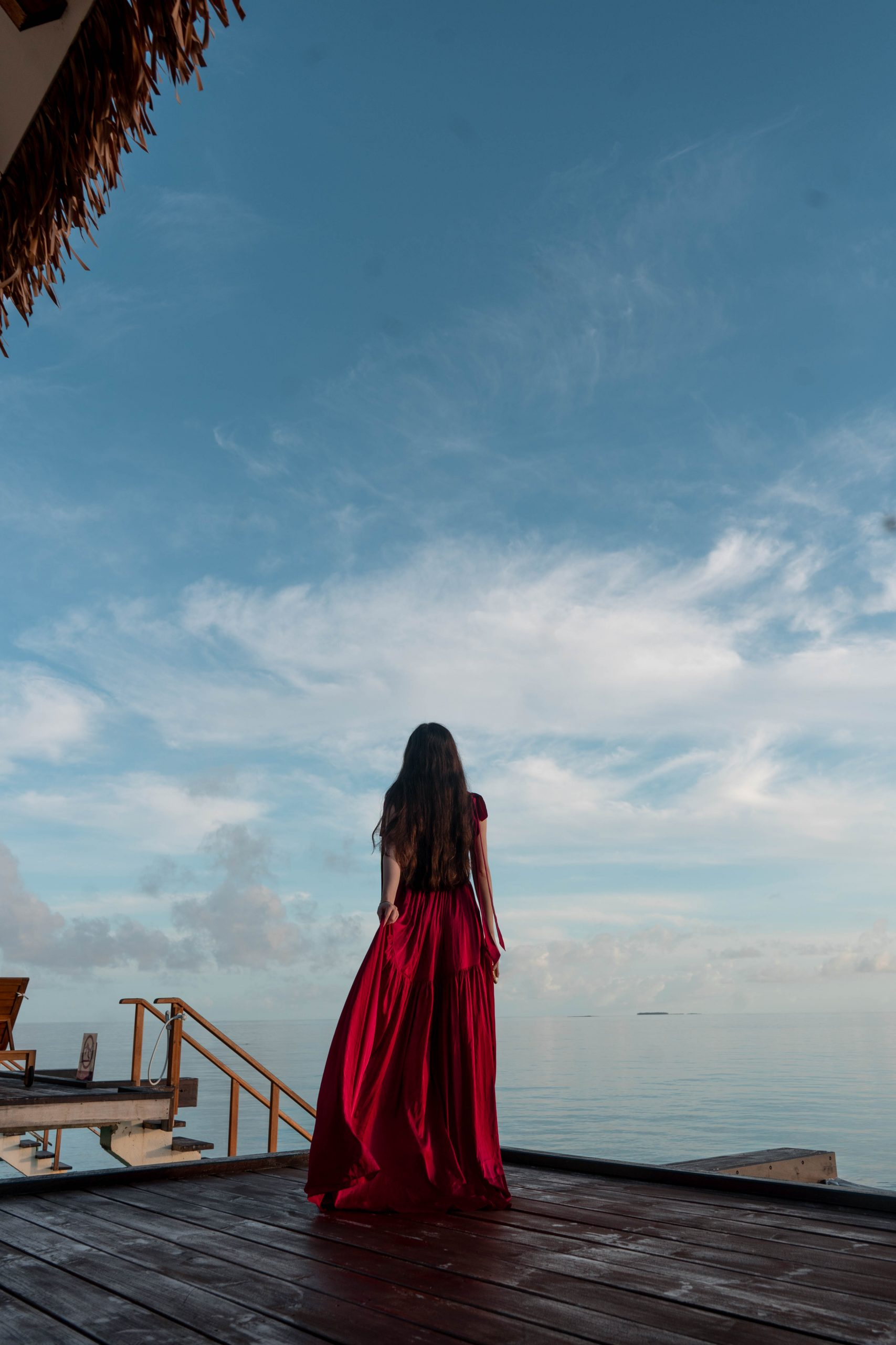 long brown wavy hair maldives overwater villa perrin and co anne dress silk maxi dress with train burgundy red indian ocean
