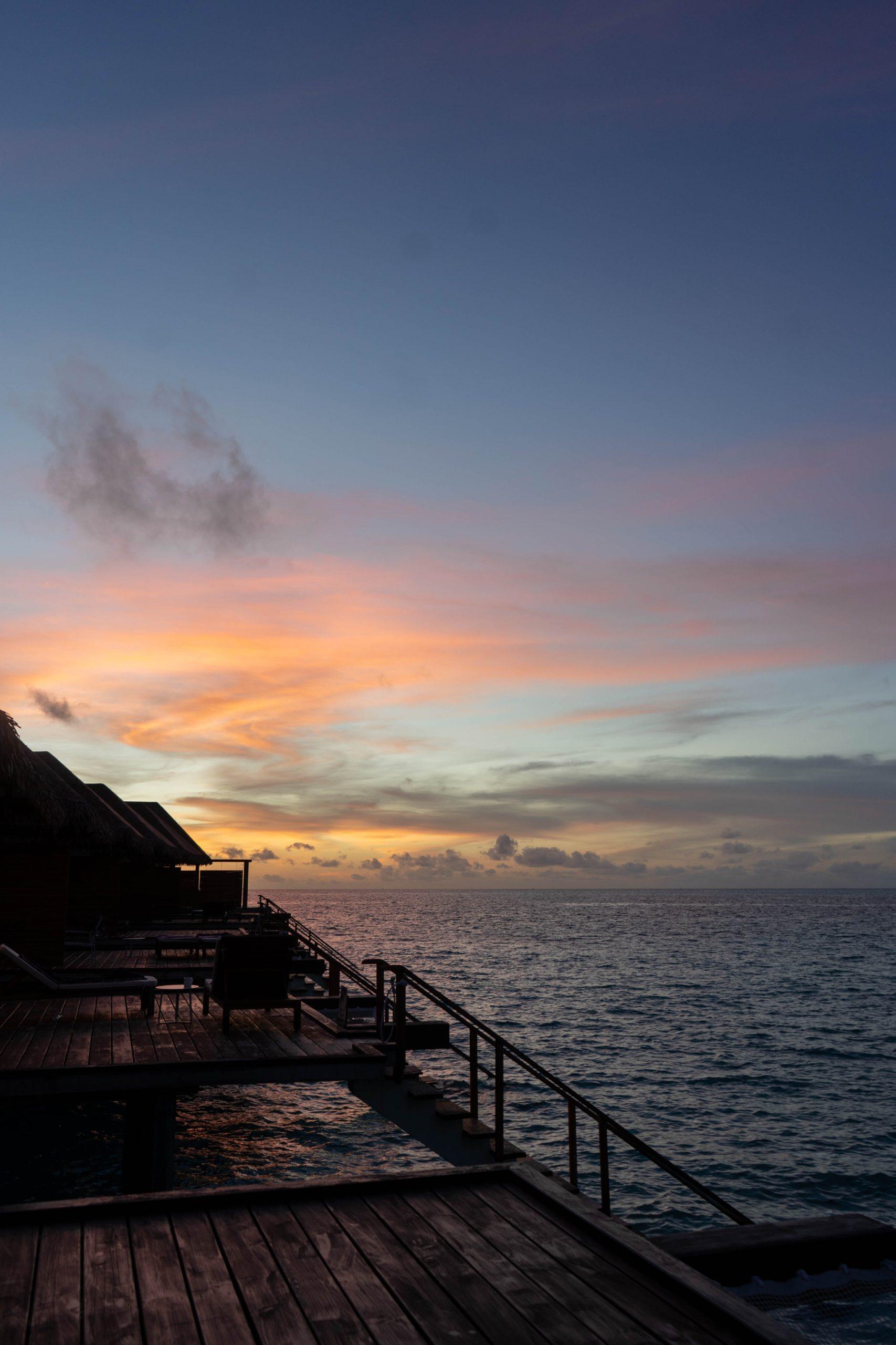 sunset overwater villa cinnamon velifushi maldives south asia indian ocean