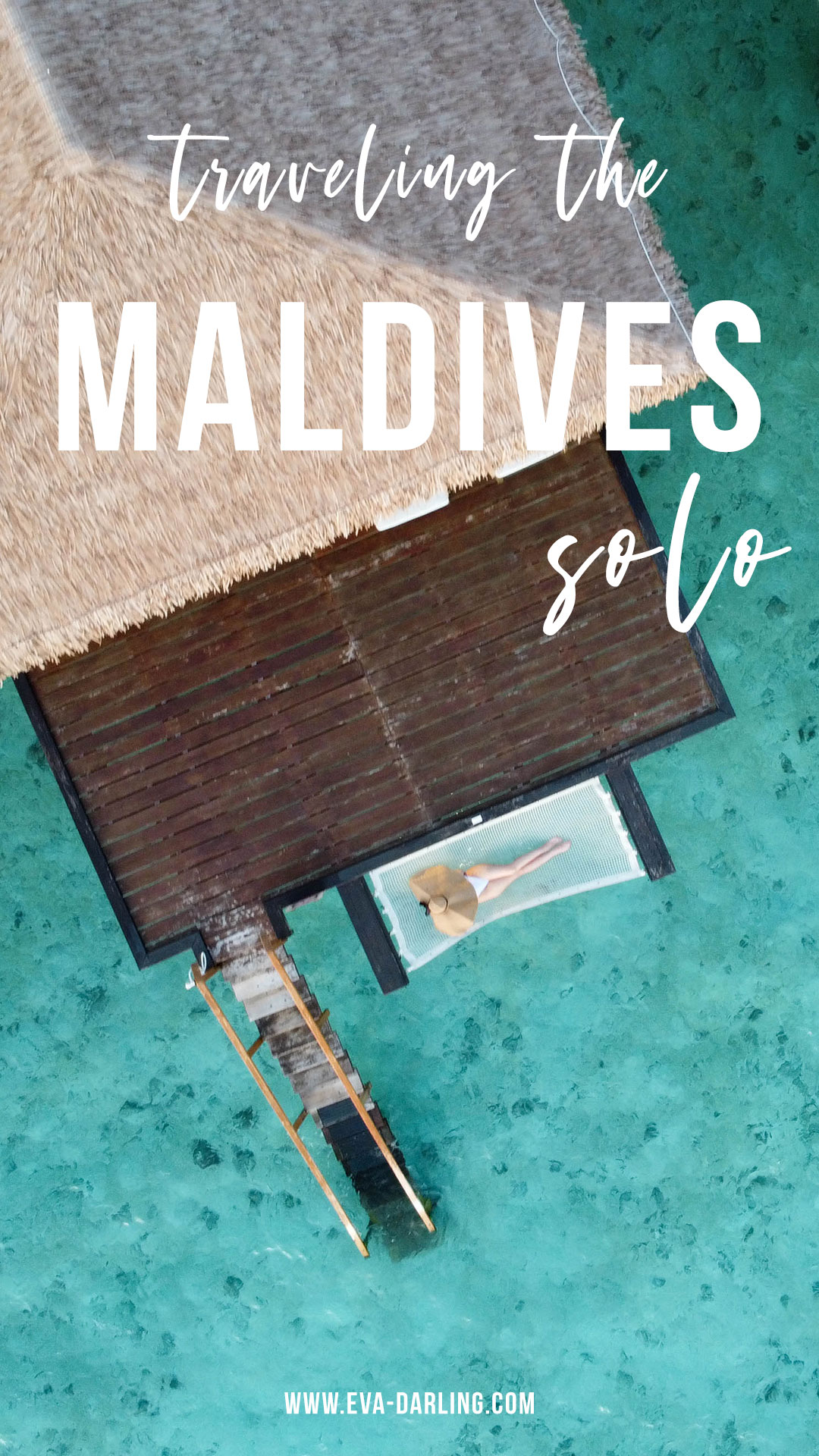 how to travel to the maldives solo woman laying down overwater hammock over water villa bungalow maldives solo female travel white one piece swimsuit large floppy hat