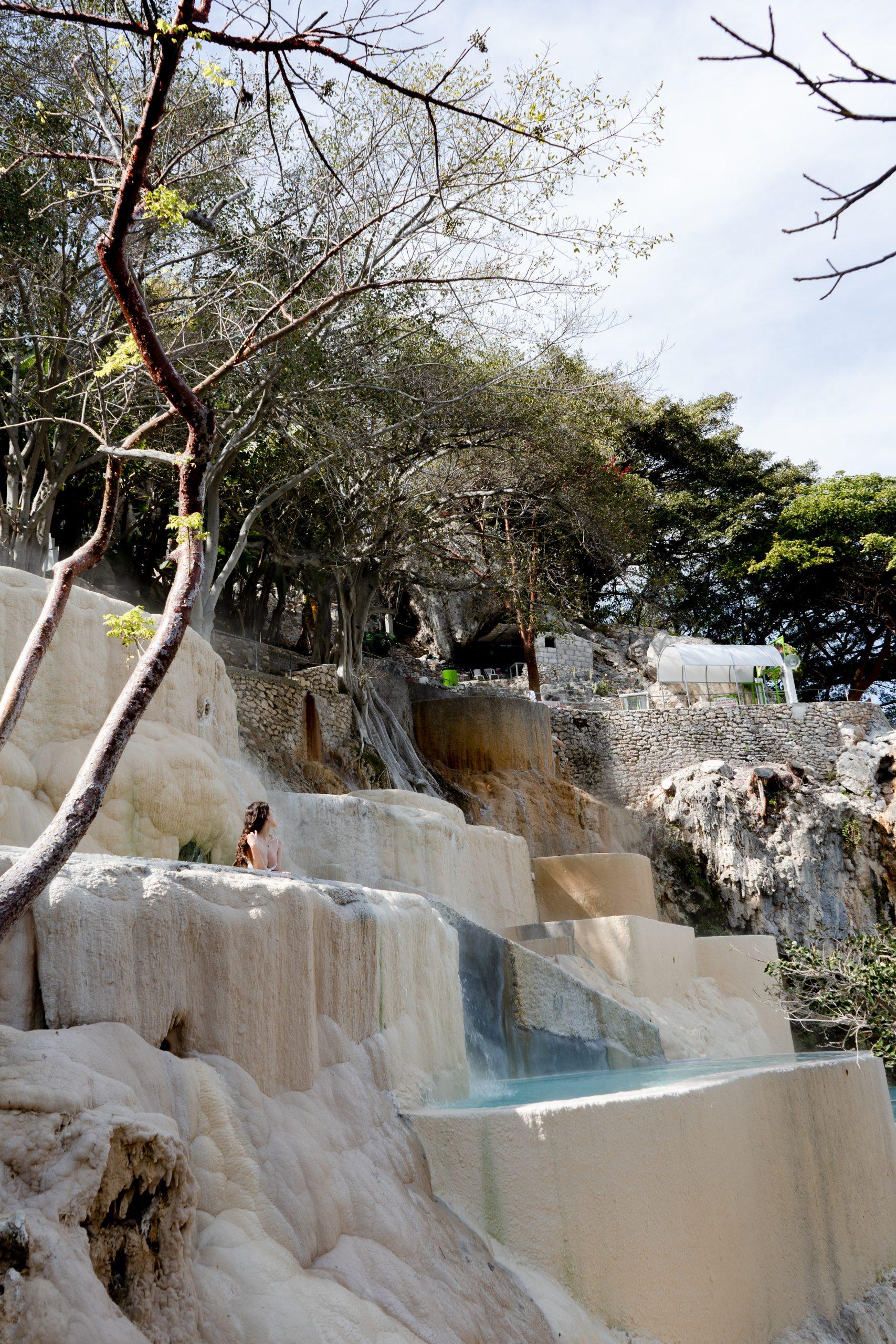 grutas tolantongo hot springs thermal pools white cliffside canyon hidalgo mexico brunette woman eva phan ecotourism attraction mexico city