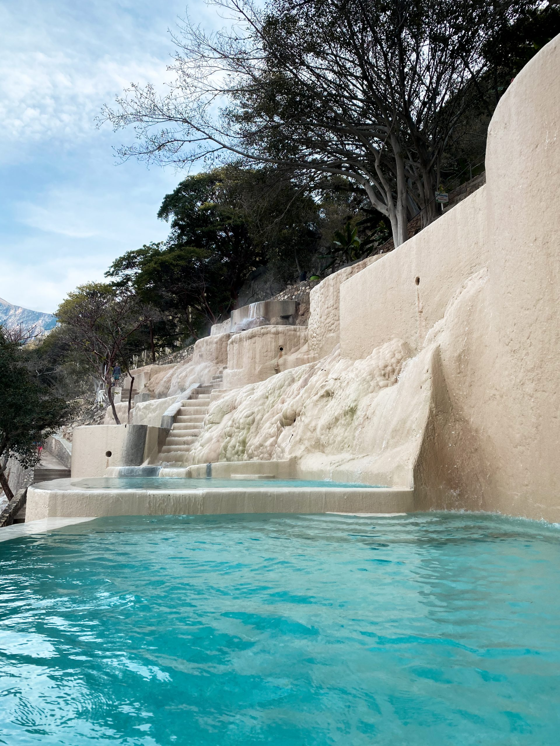 grutas tolantongo turquoise blue water carved cliff side thermal pool natural hot springs hidalgo mexico