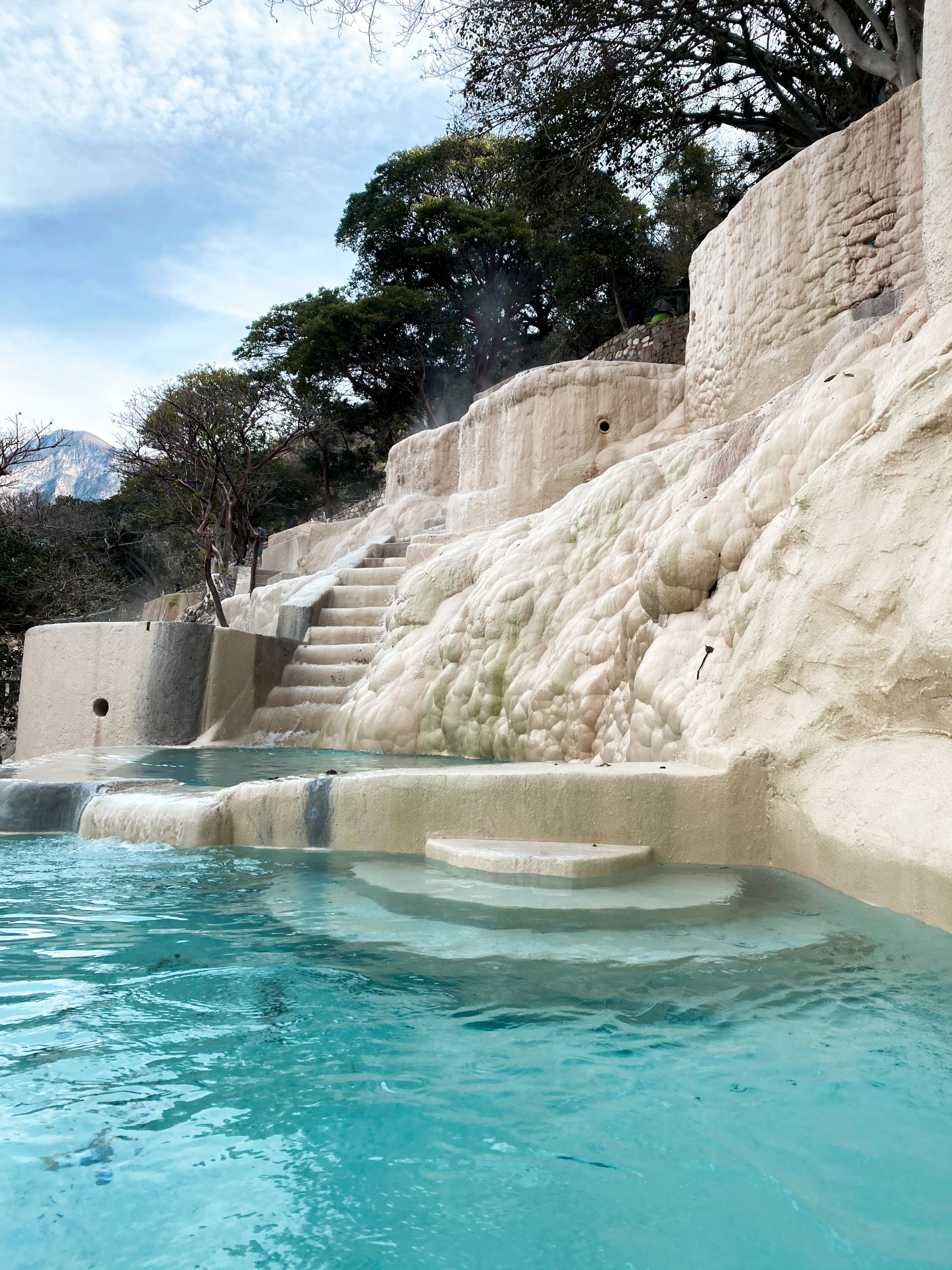 grutas tolantongo turquoise blue water carved cliff side thermal pool natural hot springs hidalgo mexico white carved stone