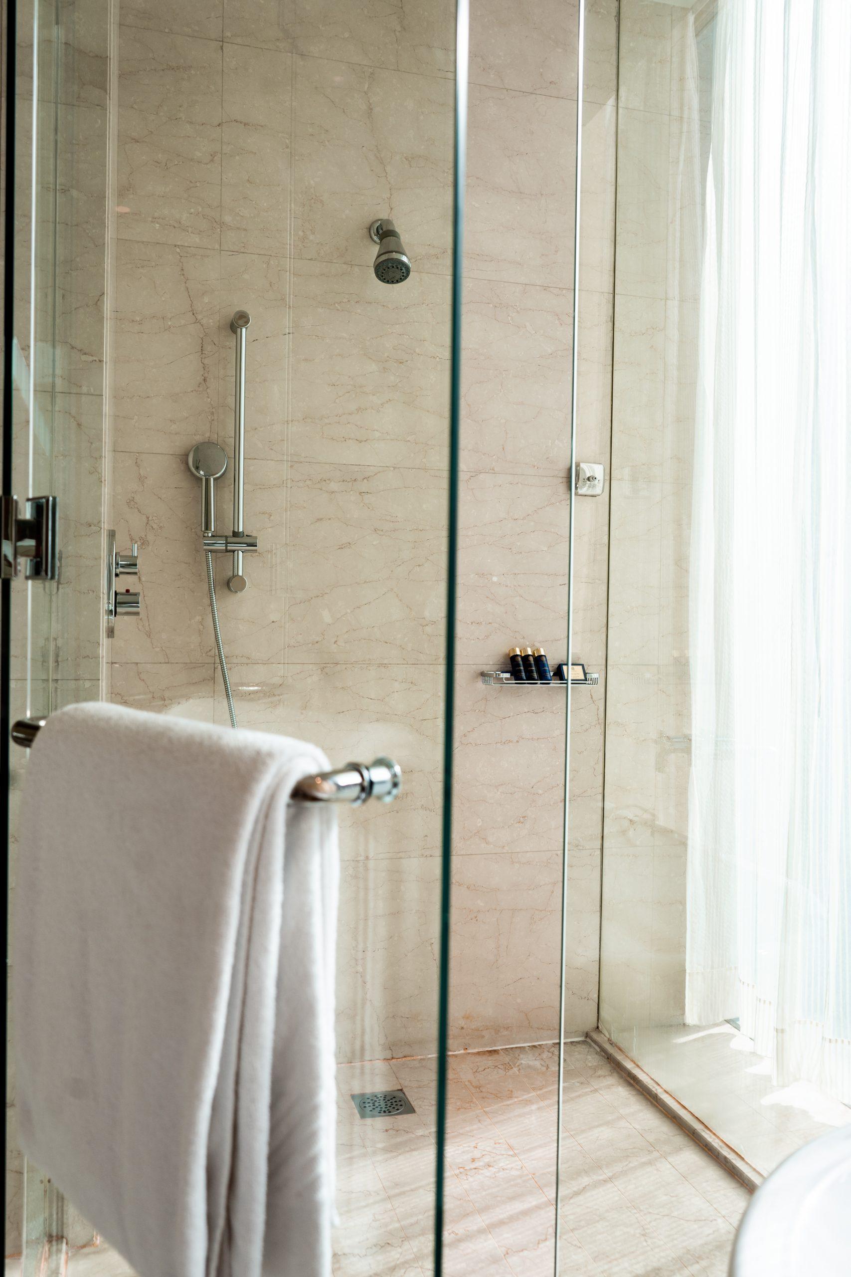 white italian marble walk in shower towel glass