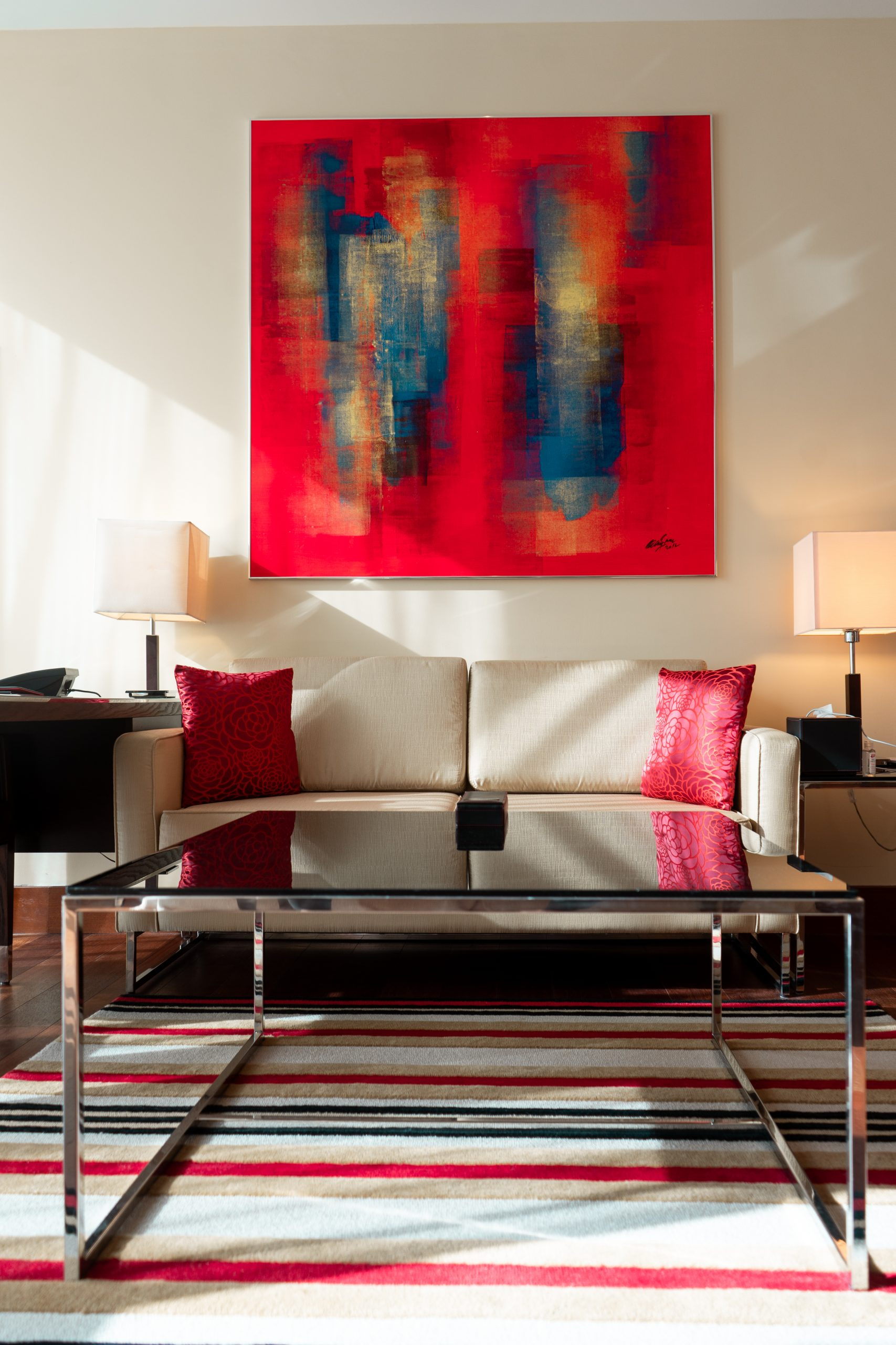 the oberoi dubai business bay hotel room couch coffee table contemporary art